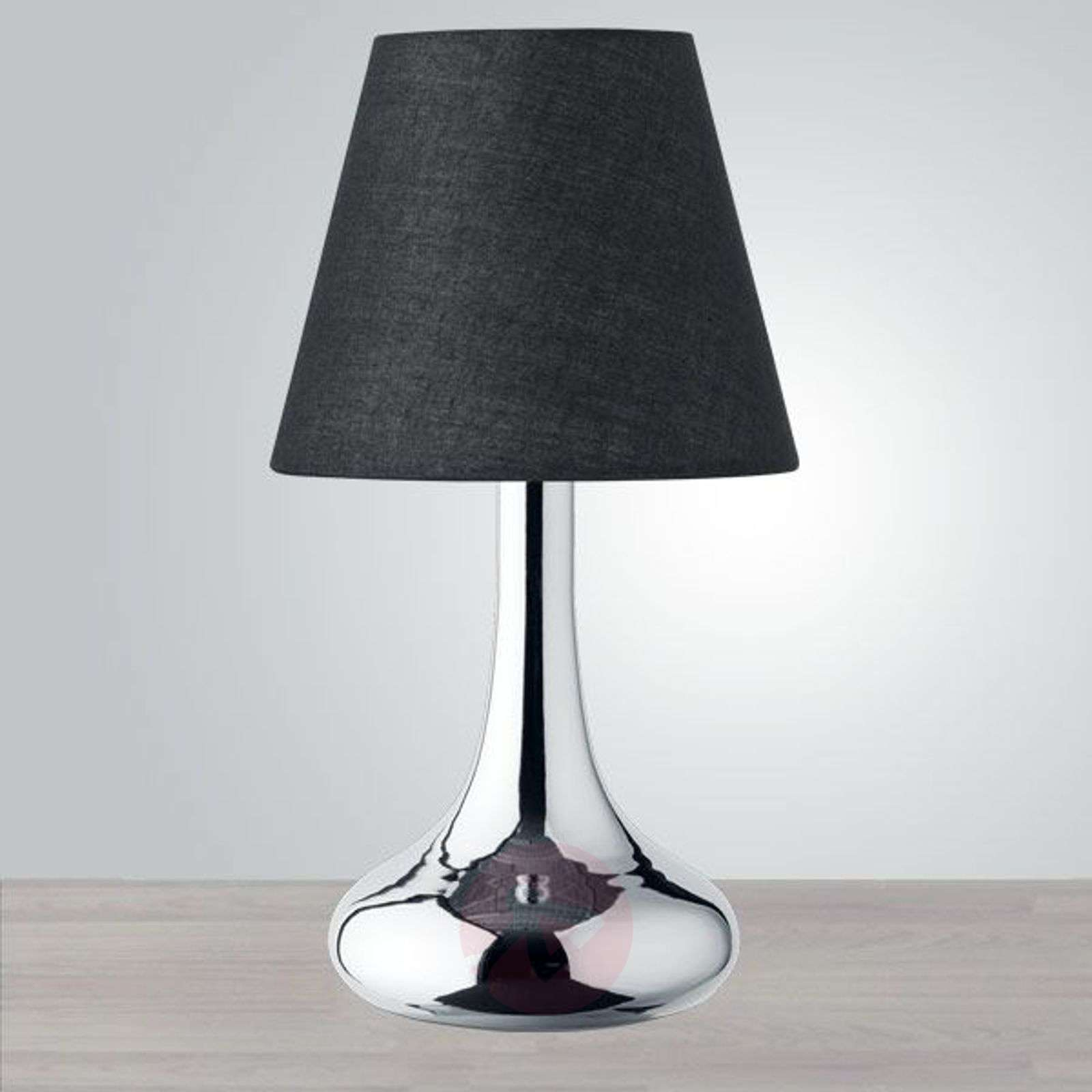lampe poser d corative avec un pied bomb. Black Bedroom Furniture Sets. Home Design Ideas